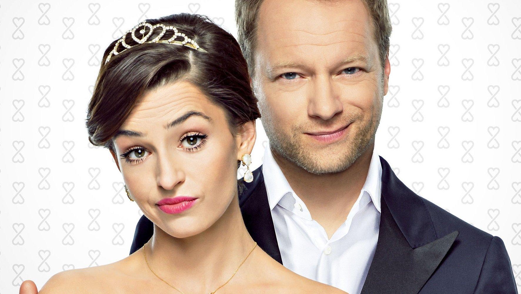 Maciej Stuhr i Agnieszka Więdłocha na plakacie filmu Planeta Singli 2